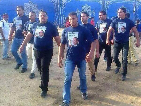 Baltagiya thugs patrolling the streets in Sisi t-shirts